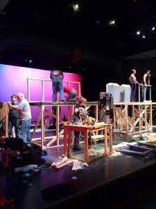 Maskarade cast members hard at work building the set!